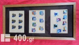 Συλλεκτικά pins των Ολυμπιακών αγώνων Αθήνα 2004 σε κορνίζα.